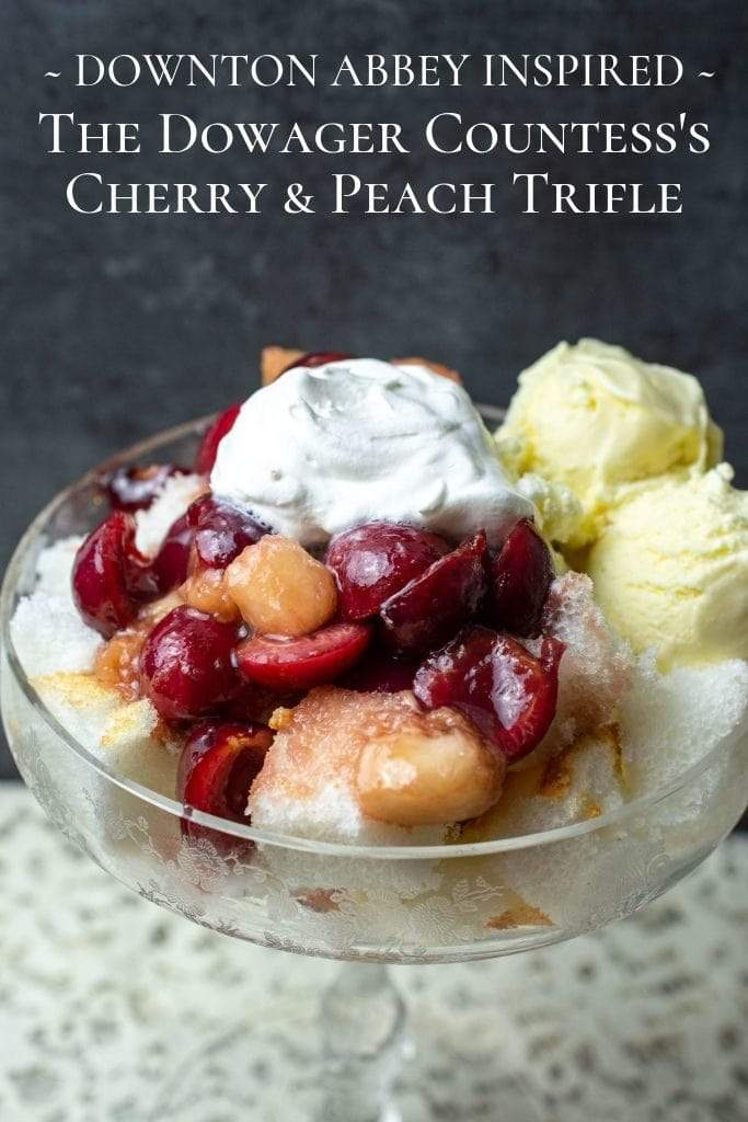 A fresh cherry and peach trifle in a crystal saucer champagne glass.