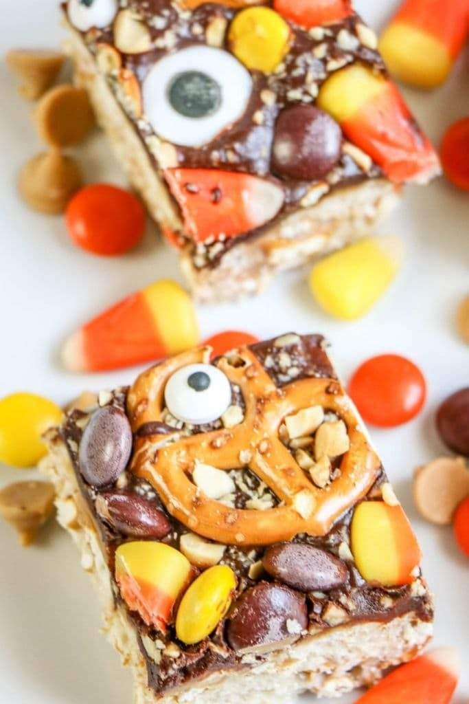 Peanut Butter and Chocolate Monster Crunch Bars cut into squares with Halloween candies.